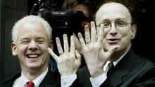 Michael Stark (L) and his same-sex partner Michael Leshner show off their wedding rings after the couple were legally married during a civil ceremony in Toronto, June 10, 2003. (ANDREW WALLACE/REUTERS)