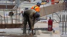 Work being done on a condominium construction site at Bathurst Street and Fork York Blvd. in Toronto on May 29, 2012. (Deborah Baic/Deborah Baic/The Globe and Mail)