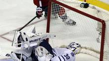 Toronto Maple Leafs goalie Ben Scrivens lies on his back as the puck goes into the goal (LARRY DOWNING/REUTERS)