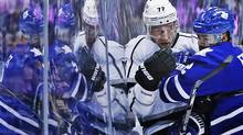 Toronto Maple Leafs' Mark Fraser, left, collides with Los Angeles Kings' Jeff Carter during first period NHL hockey action in Toronto, Wednesday December 11, 2013. (MARK BLINCH/THE CANADIAN PRESS)