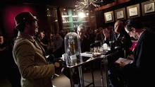 Judges watch as Toronto bartender Brad Gubbins, dressed as Inspector Clouseau, competes in Canada's World Class Bartender competition at the SoHo Metropolitan Hotel in Toronto June 10, 2013. (Moe Doiron/The Globe and Mail)