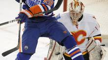 Edmonton Oilers' Ryan Jones, 28, screens Calgary Flames goalie Leland Irving during first period NHL game action in Edmonton on Friday, March 16, 2012. (John Ulan/THE CANADIAN PRESS)