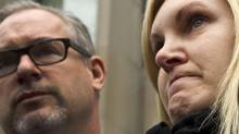 Christine Russell, the widow of Sgt. Ryan Russell, fights back tears as she speaks about Richard Kachkar, 46, being found not criminally responsible for her husband's death. (Peter Power/The Globe and Mail)
