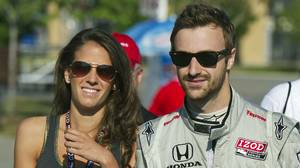 James Hinchcliffe and his girlfriend Melissa Feldhake walk to the track before practice sessions before the qualifications at the Honda Indy Toronto, July 9, 2011.