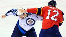 innipeg Jets left wing Andrew Ladd and Florida Panthers right wing Jack Skille fight during the third period at the BankAtlantic Center. (Steve Mitchell-US PRESSWIRE/Steve Mitchell)