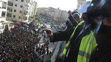 Arab League observers take photos of anti-government protesters on the streets in Adlb, Syria, on Friday, Dec. 30, 2011. (Reuters/Reuters)