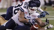 Toronto Argonauts' Ricky Foley (95) recovers Winnipeg Blue Bombers' Rory Kohlert's (87) fumble during the second half of CFL action in Winnipeg Friday, August 14, 2015.