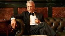Rich man in luxury, wealthy. (Jacob Wackerhausen/Photos.com)
