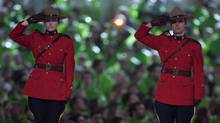 Mounties saluting during the Paralympic Opening Ceremonies in Vancouver March 12, 2010. (John Lehmann/ The Globe and Mail/John Lehmann/ The Globe and Mail)