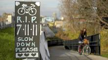 On the West Toronto Railpath, near the site of cyclist Jenna Morrison's fatal accident, a makeshift memorial sign (Lisan Jutras for The Globe and Mail/Lisan Jutras for The Globe and Mail)