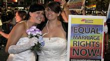 In this March 5, 2011 file photo, two women in support of same sex marriages march during the Gay and Lesbian Mardi Gras, in Sydney, Australia. (Rob Griffith/AP)