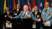 Veteran Ron Clarke joins fellow veterans and PSAC members as they hold a news conference on Parliament Hill on Jan. 28, 2014. (SEAN KILPATRICK/THE CANADIAN PRESS)