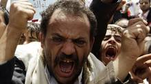 Anti-government protesters shout slogans during a rally to demand the ouster of Yemen's President Ali Abdullah Saleh outside Sanaa University Thursday. (AMMAR AWAD/REUTERS)