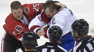 Ottawa Senators Chris Neil fights Montreal Canadiens Travis Moen as NHL officials look on during second period pre-season NHL hockey action in Ottawa on Saturday September 25, 2010 THE CANADIAN PRESS/Pawel Dwulit