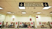 People wait to see a doctor in the Emergency/Trauma Unit waiting area at Sunnybrook Hospital on December 5, 2010. (JENNIFER ROBERTS FOR THE GLOBE AND MAIL/JENNIFER ROBERTS FOR THE GLOBE AND MAIL)