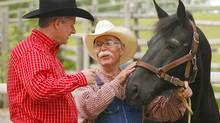Prime Minister Stephen Harper is greeted by Bill Smith and his horse Nip at Heritage Park before his annual Prime Minister's BBQ during the Calgary Stampede on Saturday. (TODD KOROL)