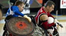 Great Britain's Andrew Barrow, left, gets tangled up in the wheels of Canada's David Willsie during action in the first game of World Wheelchair Rugby match in Richmond September 21, 2010. Canada went on to beat Great Britain 48-41. (JOHN LEHMANN/JOHN LEHMANN/THE GLOBE AND MAIL)