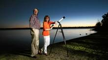 June 13, 2012: Holly Larocque and her husband Paul Baker looks to the sky for a satellite in Ottawa. She launched the ashes of her dad on a satellite that is now circling the globe. (Dave Chan For The Globe and Mail)