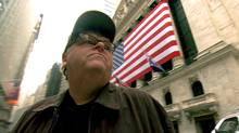 Michael Moore on Wall Street in a scene from Capitalism: A Love Story.