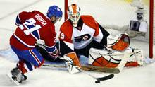 Montreal Canadiens' Brian Gionta, left, sends his shot past Philadelphia Flyers goaltender Michael Leighton during third period of Game 3 NHL Eastern Conference finals Thursday, May 20, 2010 in Montreal. (Paul Chiasson/THE CANADIAN PRESS)