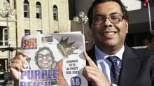 Newly elected mayor of Calgary Naheed Nenshi holds a local paper declaring him mayor of Calgary, a day after being elected in Calgary, Alberta, October 19, 2010. (JACK CUSANO/REUTERS)