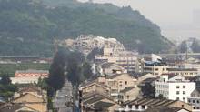 A pile of rubble on a hillside is all that remains of the Sanjiang Church in Wenzhou, China, May 3, 2014. Citing violated zoning regulations, officials demolished the church on April 28, angering many in this city of nine million now at the center of a national battle being waged by a Communist Party increasingly suspicious of Christianity and the Western values it represents. (SIM CHI YIN/NYT)