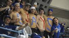 From left and shirtless, emblazoned with the word Jays on their chests are Tony Mitilineos, Joe Ferraro, Adriano Bernaudo, Donald Walsh and Mark Forgione (all post secondary students) during the Toronto Blue Jays home opener against the Boston red Sox at the Rogers centre on April 9 2012. They were photographed in the 500 level seats of the Roger Centre. (Fred Lum/Fred Lum/The Globe and Mail)