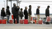 People in Fukushima line up for home heating fuel on March 20, 2011. (Wally Santana/AP)