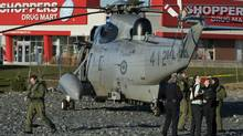 A Sea King helicopter sits in a vacant parking lot in the Halifax neighbourhood of Bedford on Thursday. The Department of National Defence says the choppr was on a training flight from Canadian Forces Base Shearwater when it experienced problems with its hydraulics and made an emergency landing. No injuries were reported. (Andrew Vaughan/THE CANADIAN PRESS)