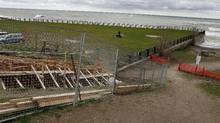 An incomplete public staircase leading to Lake Ontario lies barricaded behind a fence beside the R.C Water Filtration Plant in the Beaches neighbourhood of Toronto. (Fernando Morales/Fernando Morales / The Globe and Mail)