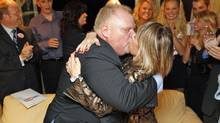 Rob Ford kisses his wife on Oct. 25, 2010, after learning that he had been declared winner of the Toronto mayoral election. (Peter Power/Peter Power/The Globe and Mail)