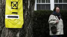 A voter leaves a Toronto polling station during the federal election on May 2, 2011 (MARK BLINCH/Mark Blinch/Reuters)