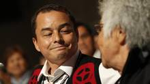 The current Chief of The Assembly of First Nations, Shawn Atleo, smiles only slightly at his great aunt, Gertrude Frank, right, after the results of the first ballot were announced. (Peter Power/The Globe and Mail)