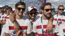 Filed hockey players Philip Wright, Ian Smith and Richard Hildreth, left to right, watch a performance as they attend the Canadian team's their welcome ceremony at the Commonwealth Games in Glasgow, Scotland on Monday, July 21, 2014. (Andrew Vaughan/THE CANADIAN PRESS)