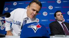 Toronto Blue Jays General Manager Alex Anthopoulos, right, introduces new Blue Jays manager John Gibbons, left, before speaking to he media during a press conference in Toronto on Tuesday, Nov. 20, 2012. (The Canadian Press)