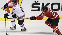 John Tavares of Canada (R) challenges Switzerland's Matthias Bieber during their preliminary round group B game at the Ice Hockey World Championships in Kosice May 3, 2011. (PETR JOSEK)