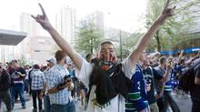 A Vancouver Canucks fan salutes during a riot following Game 7 of the NHL Stanley Cup final in downtown Vancouver on Wednesday, June 15, 2011. (Geoff Howe/ The Globe and Mail/Geoff Howe/ The Globe and Mail)