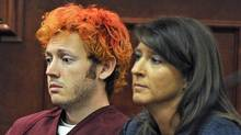 James Holmes, left, appears in Arapahoe County District Court with defence attorney Tamara Brady on July 23, 2012, in Centennial, Colo. (RJ Sangosti/The Associated Press)