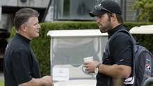Todd Bertuzzi, right, talks with Marc Crawford prior to the start of a charity golf tournament in Surrey, B.C., Tuesday, Aug. 16, 2005. (RICHARD LAM/The Canadian Press)