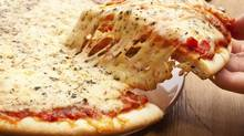 Big pizza manufacturers will get special cheese licences. (Olga Nayashkova/Getty Images/iStockphoto)
