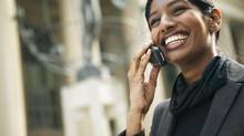 Happy woman on cell phone (Hemera Technologies/Getty Images)