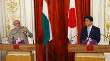 India's Prime Minister Narendra Modi and Japan's Prime Minister Shinzo Abe attend a joint news conference at the state guest house in Tokyo on September 1, 2014. (Shizuo Kambayashi/Reuters)