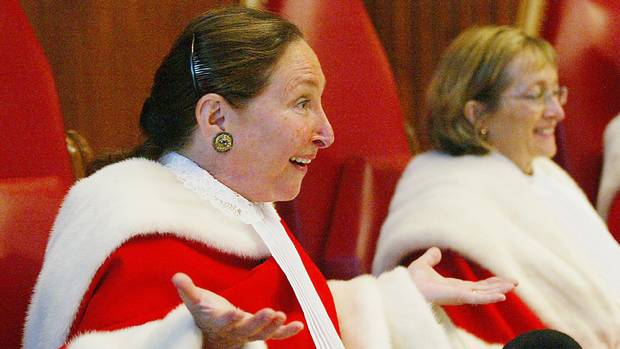 Justice Rosalie Abella gestures during a swearing-in ceremony as Justice Marie Deschamps looks on at the Supreme Court of Canada for her and Justice Louise Charron, in Ottawa, Monday Oct. 4, 2004.