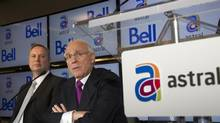 Bell Canada Enterprises (BCE) president and chief executive officer George Cope (L) and Ian Greenberg (R), president and chief executive officer of Astral Media Inc., speak at a news conference in Montreal in this March 16, 2012 file photo. (Christinne Muschi/Reuters)
