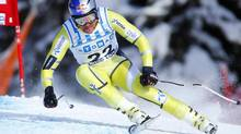 Norwegian skier Aksel Lund Svindal makes a turn while posting the fastest time so far during the first alpine skiing Men's World Cup downhill of the season in Lake Louise, Alberta, November 24, 2012. (MIKE BLAKE/REUTERS)