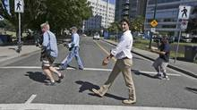 Justin Trudeau crossing the street in Vancouver on July 25, 2013. (Darryl Dyck for The Globe and Mail)