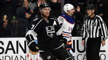 Nov 17, 2016; Los Angeles, CA, USA; Los Angeles Kings center Jeff Carter (77) celebrates after a goal in the second period as Edmonton Oilers right wing Jordan Eberle (14) reacts during a NHL hockey game at Staples Center. (Kirby Lee/USA Today Sports)