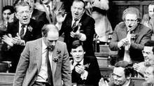 DECEMBER 2, 1981: Prime Minister Pierre Trudeau gets a rousing cheer from fellow Liberal members of Parliament in the House of Commons Dec. 2, while voting on constitutional package. The House voted 246-24 in favour of passage of the Constitution, which includes a new Charter of Rights and Freedoms. (Andy Clark/UPC)