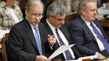 Quebec's Finance Minister Raymond Bachand tables the provincial budget at the National Assembly on March 20, 2012. (MATHIEU BELANGER/Mathieu Belanger/Reuters)