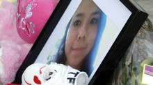 Photo of 15 year old Tina Fontaine at vigil sits on the Alexander Docks along the Red river from which her body, in a bag, was recovered Sunday in Winnipeg Manitoba, August 19, 2014. (LYLE STAFFORD For The Globe and Mail)